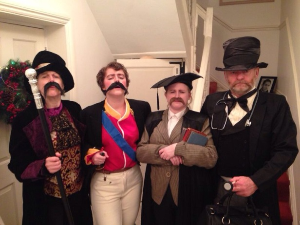 A group photo. My family all dressed as victorian gentlemen, including waistcoats, fake moustaches, top hats! My sister is dressed in a military outfit, I'm dressed as a school master, my dad is dressed is a doctor and my mum is dressed as a showman!