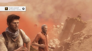 Two male characters, Nathan Drake and Sullivan are running through a sand storm in a desert. From the Uncharted Series.