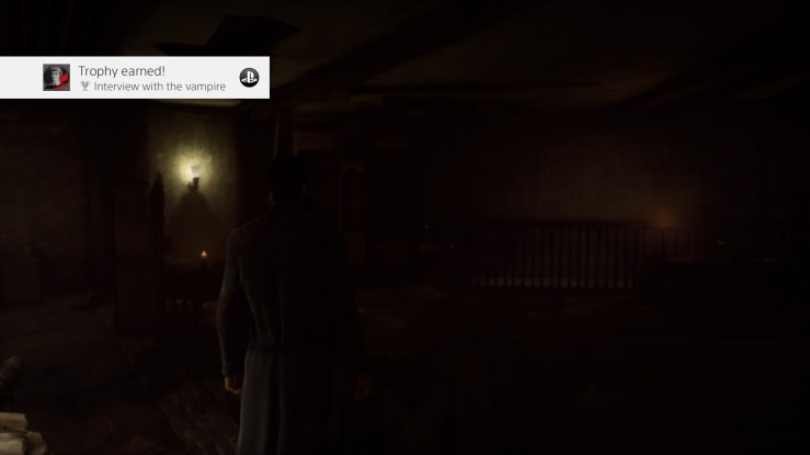 A screen shot of the game Vampyr. The image is so dark it's hardly visible. The shape of a man is just perceptible to the left of the image.